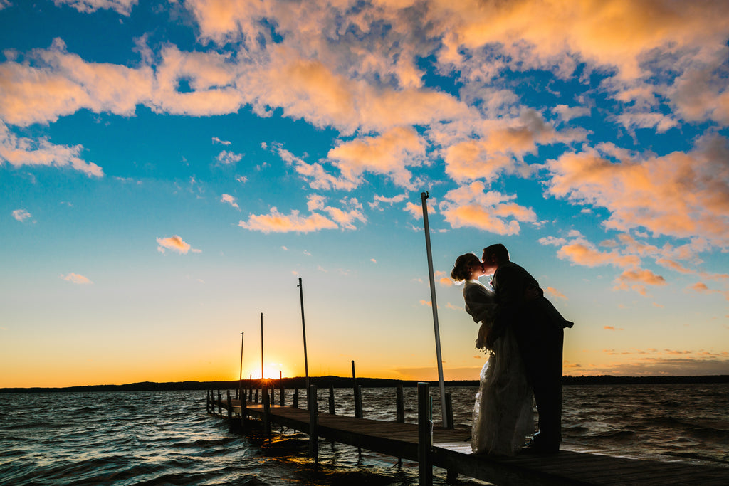 An outdoor wedding photo of a lakeside sunset | Photo by Tim Larsen | Stunning Wedding Photos to Inspire Your Big Day! | Kennedy Blue