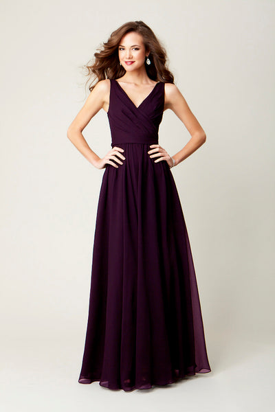 A long, chiffon bridesmaid dress in eggplant is perfect for a winter-themed wedding.