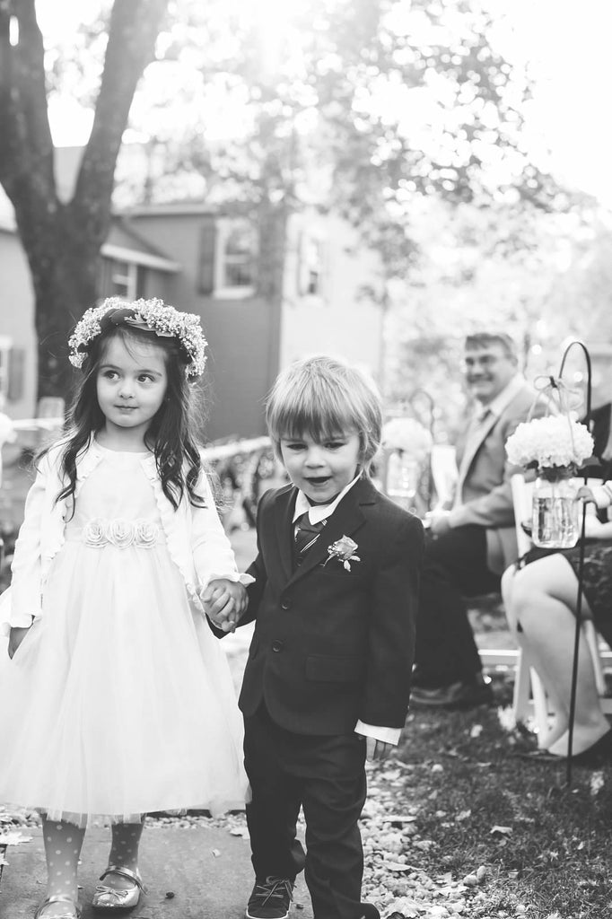 A sweet wedding photo of the flower girl and ring bearer | Photo by Veronica Lola Photography | Stunning Wedding Photos to Inspire Your Big Day! | Kennedy Blue