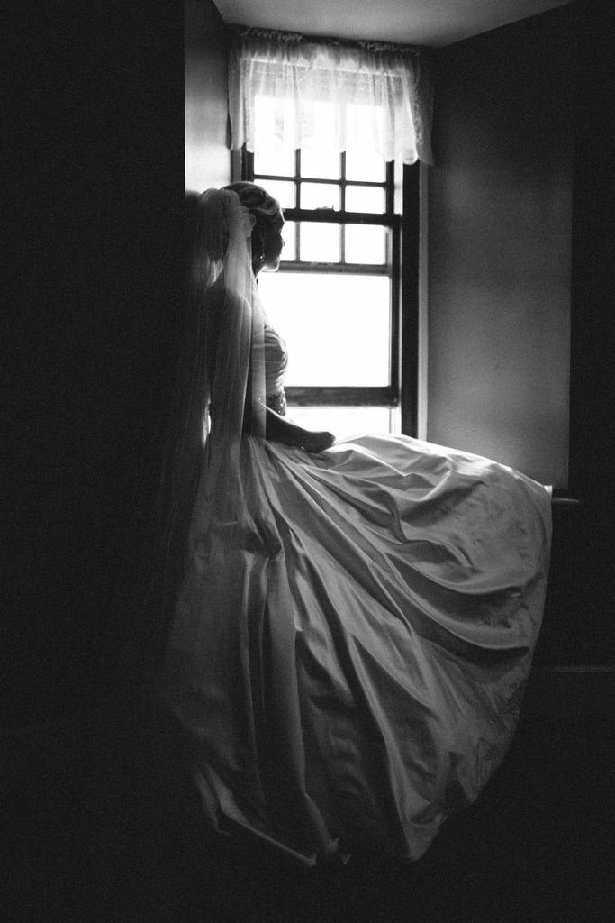 A romantic photo of the bride in her wedding dress | Photo by We Laugh We Love Photography | Stunning Wedding Photos to Inspire Your Big Day! | Kennedy Blue
