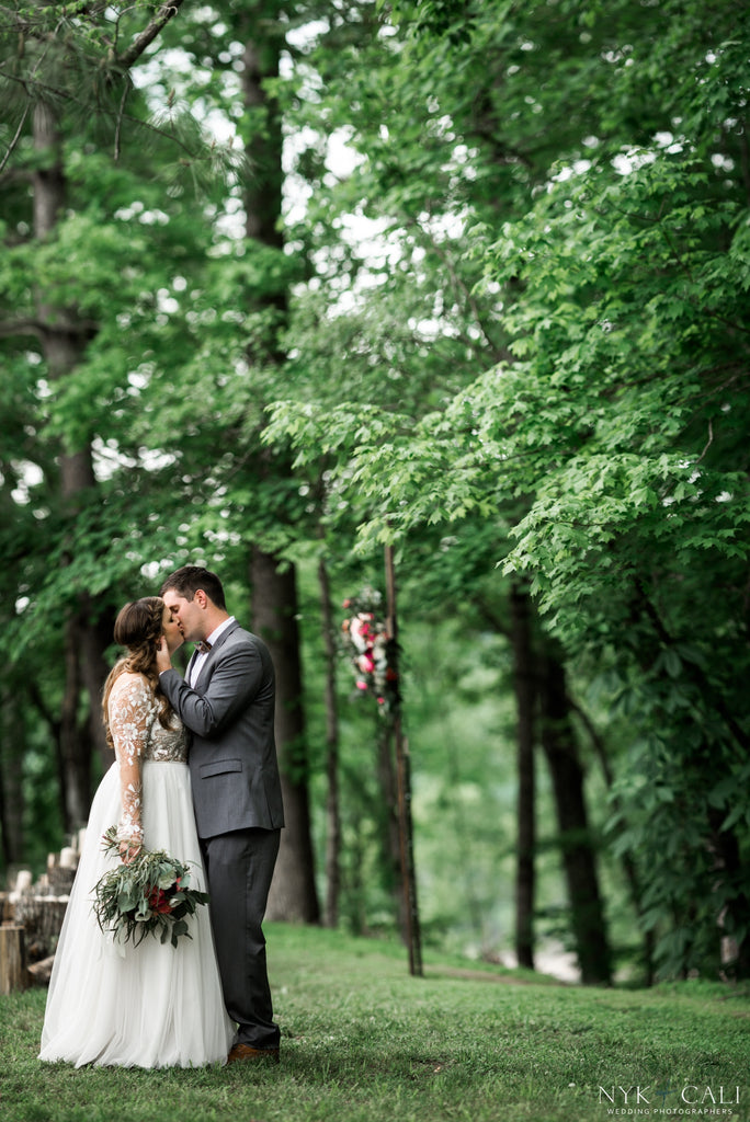 A rustic, outdoor wedding picture of the bride and groom | Photo by Nyk & Cali Photography | Stunning Wedding Photos to Inspire Your Big Day! | Kennedy Blue