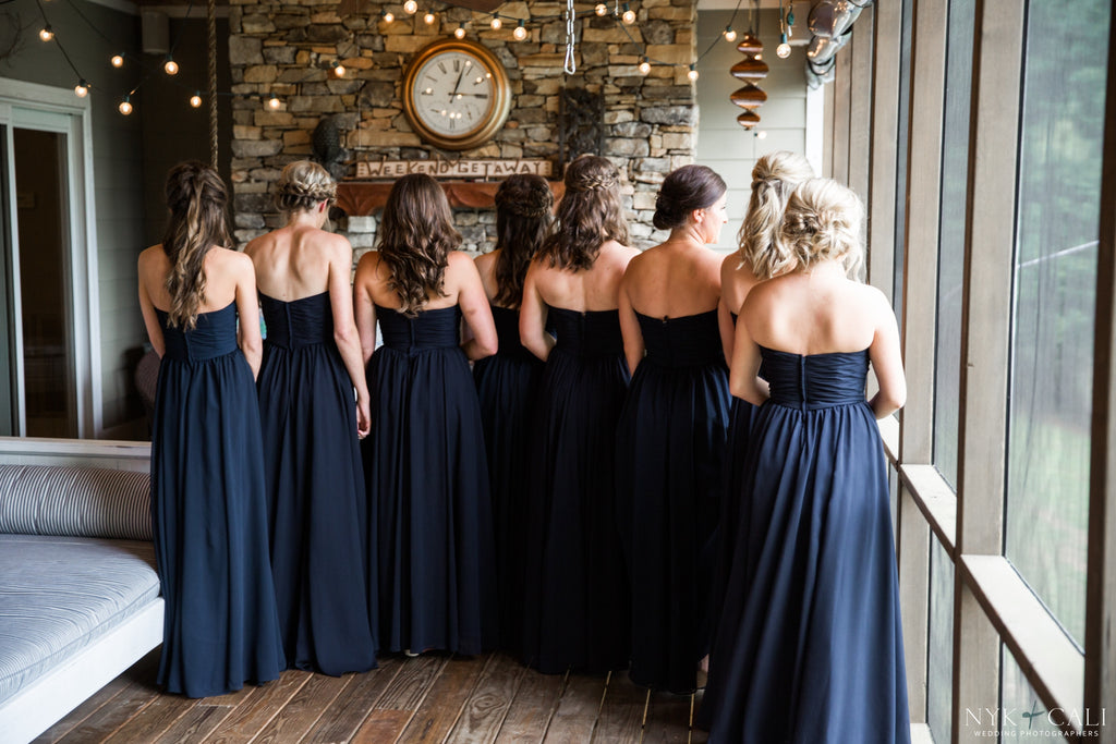 The bridal party showing off the back of their navy blue dresses! | Beautiful Navy Bridal Parties | Kennedy Blue | Nyk & Cali Photography
