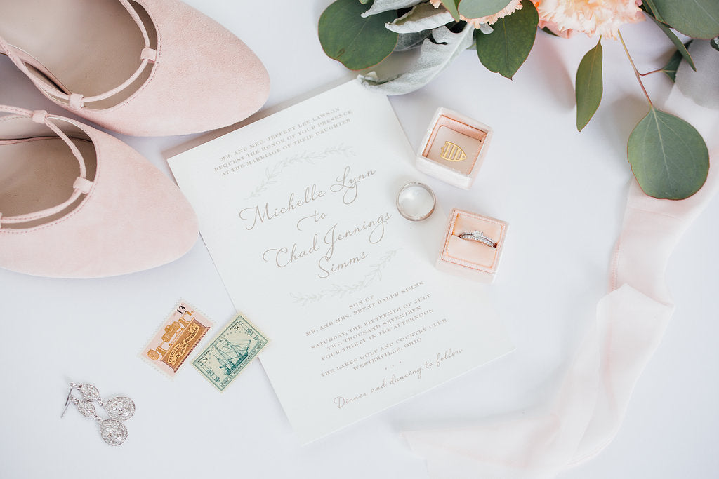 Look at this gorgeous styled photo of the brides shoes and invitations! | A Simple & Stunning Sage Wedding | Kennedy Blue | Rachel Figueroa Photography