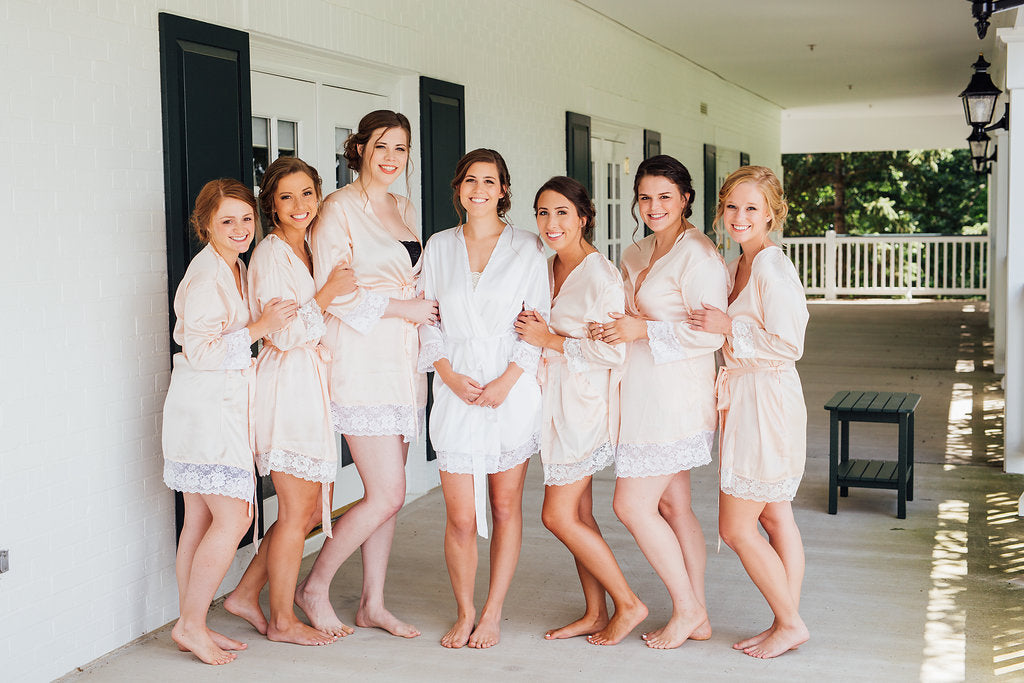 The bride and her bridesmaids in their matching robes! | A Simple & Stunning Sage Wedding | Kennedy Blue | Rachel Figueroa Photography