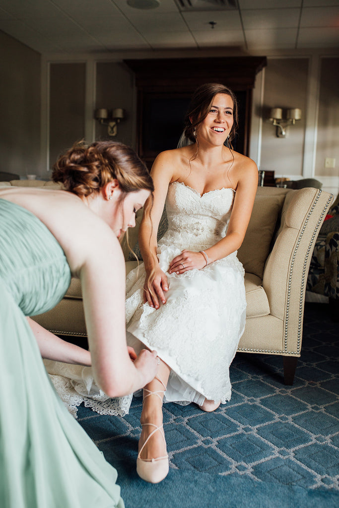 A cute photo of the bride getting ready! | A Simple & Stunning Sage Wedding | Kennedy Blue | Rachel Figueroa Photography