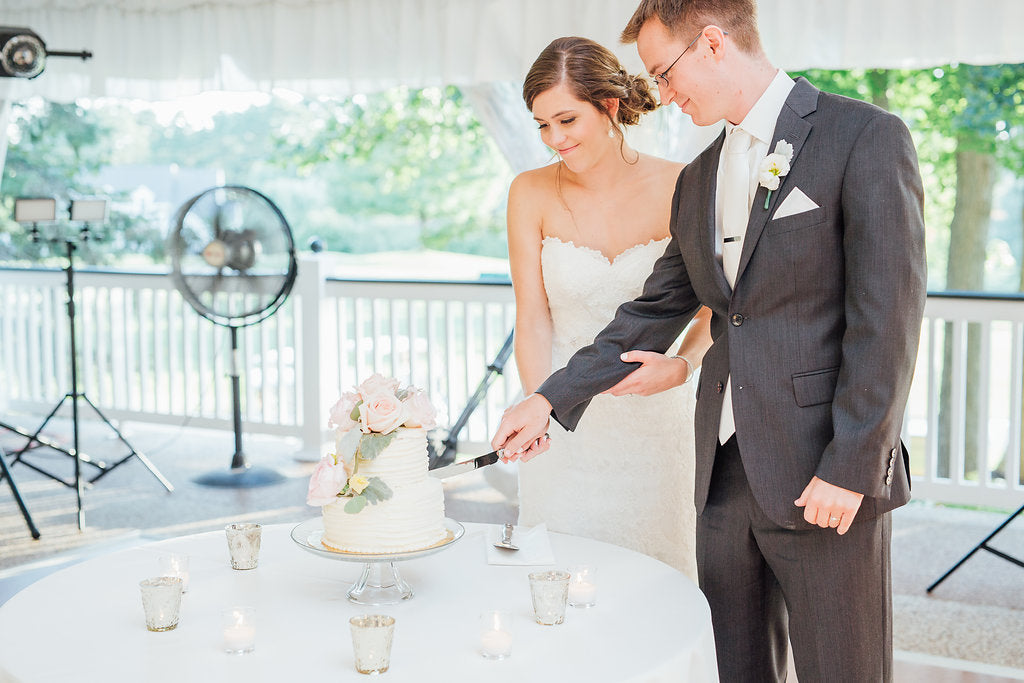 The bride and groom cutting the cake! | A Simple & Stunning Sage Wedding | Kennedy Blue | Rachel Figueroa Photography