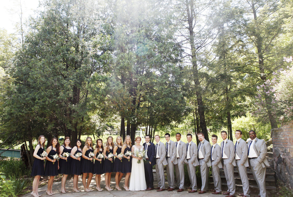 What a gorgeous wedding party with navy bridesmaids and light grey groomsmen! | Beautiful Navy Bridal Parties | Kennedy Blue | Hannah Schmitt Photography