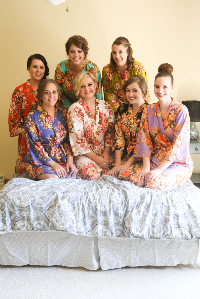 Gift your bridesmaids floral, silk robes that they can enjoy even long after the wedding day! See all of the details from Jenna and Nate's rustic wedding in Wisconsin. | A Charming Blue and Yellow Wedding