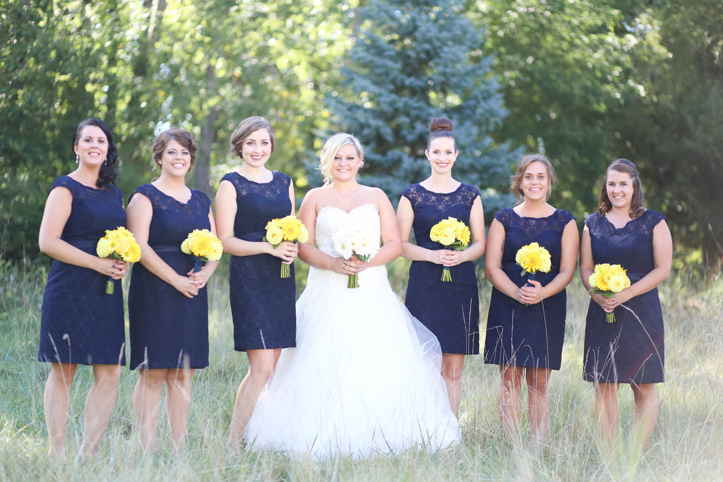 These navy, short, lace bridesmaid are absolutely stunning! See all of the details from Jenna and Nate's rustic wedding in Wisconsin. | A Charming Blue and Yellow Wedding