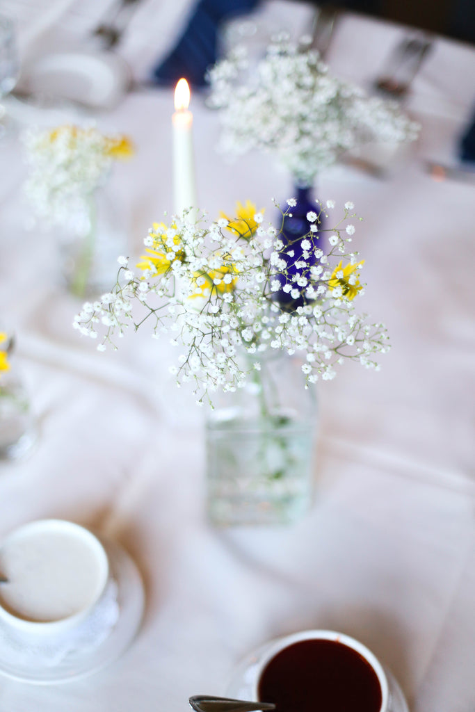 We love these simple and dainty table centerpieces. See all of the details from Jenna and Nate's rustic wedding in Wisconsin. | A Charming Blue and Yellow Wedding