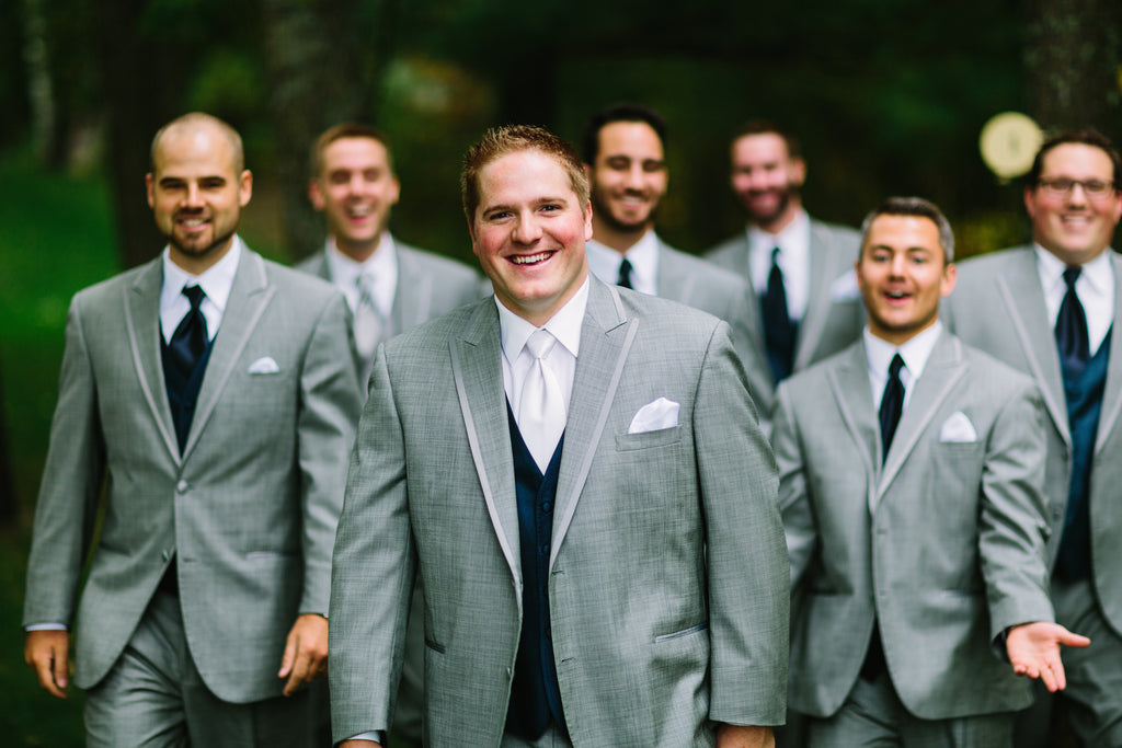 The groom and his men outfitted in gray and navy suits | A Nautical-Inspired Wedding Day