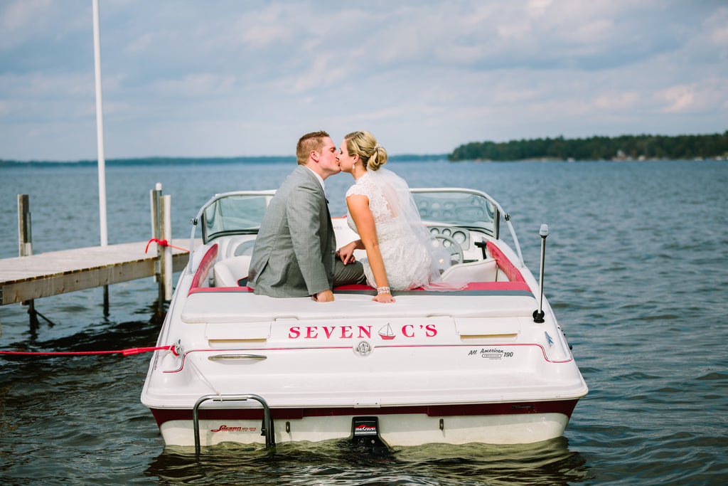 The couple's engagement took place on their boat. So romantic! | A Nautical-Inspired Wedding Day