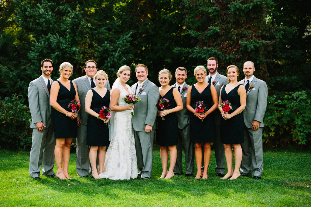 A stunning navy and gray bridal party | A Nautical-Inspired Wedding Day