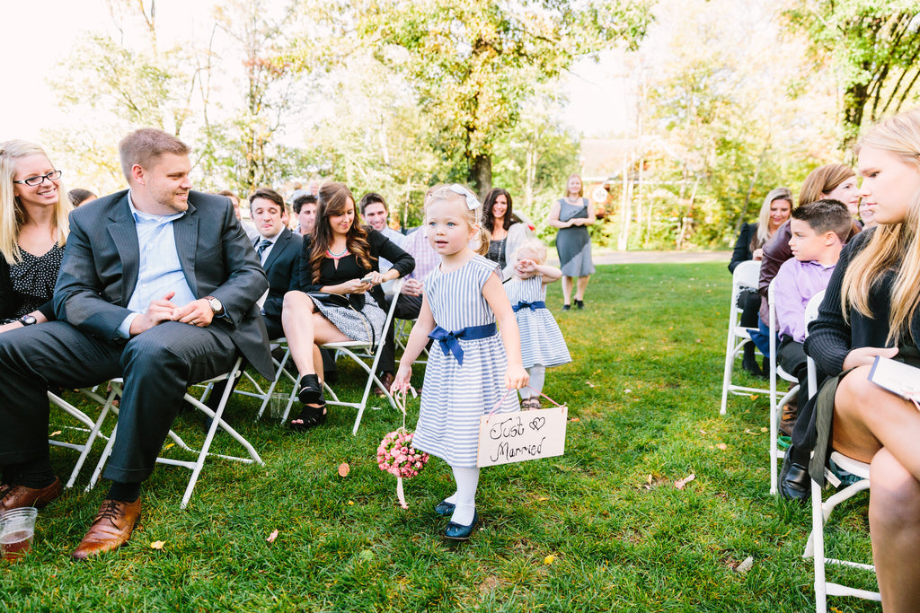 The adorably sweet flower girls | A Nautical-Inspired Wedding Day