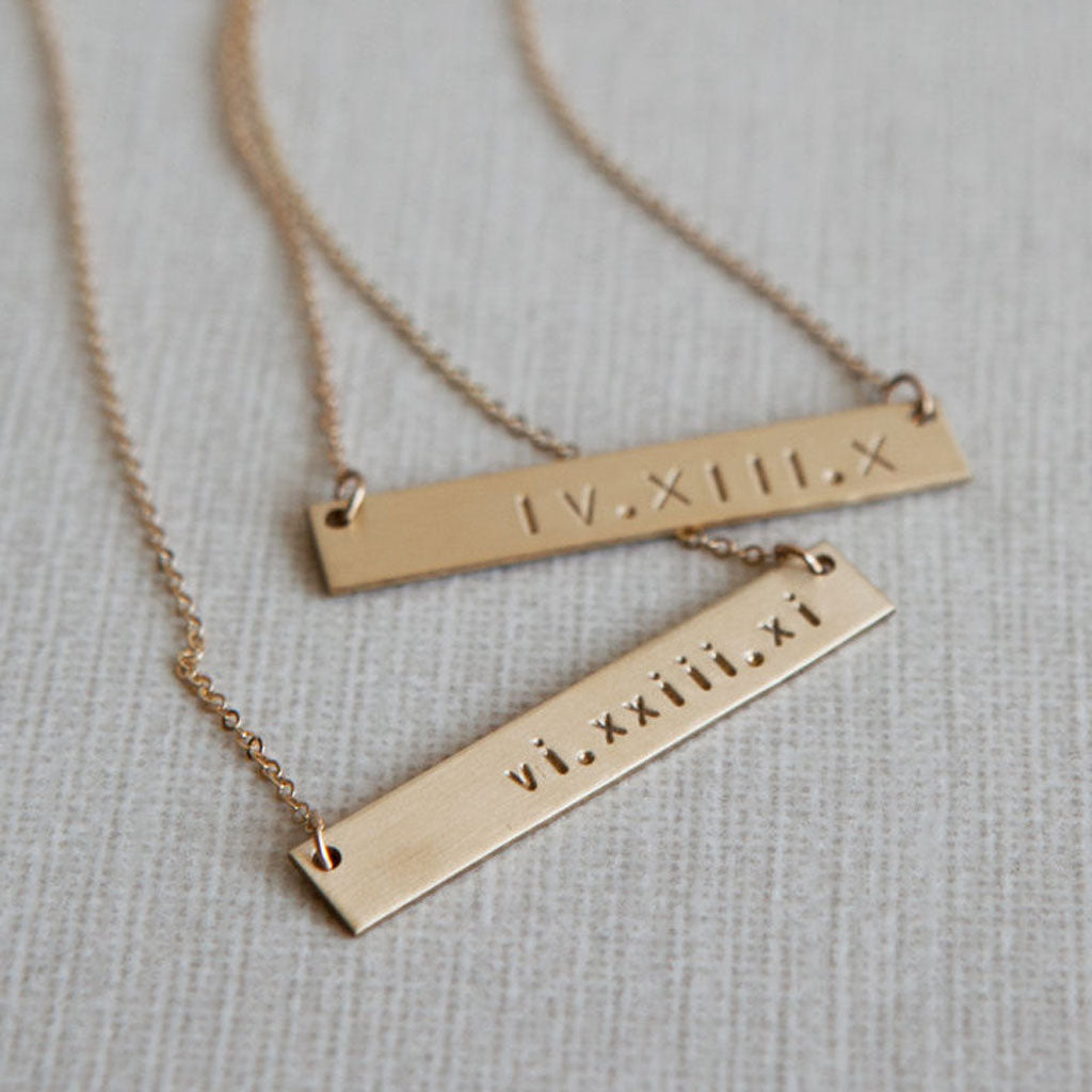 A hand-stamped bar necklace from LEILAjewelryshop
