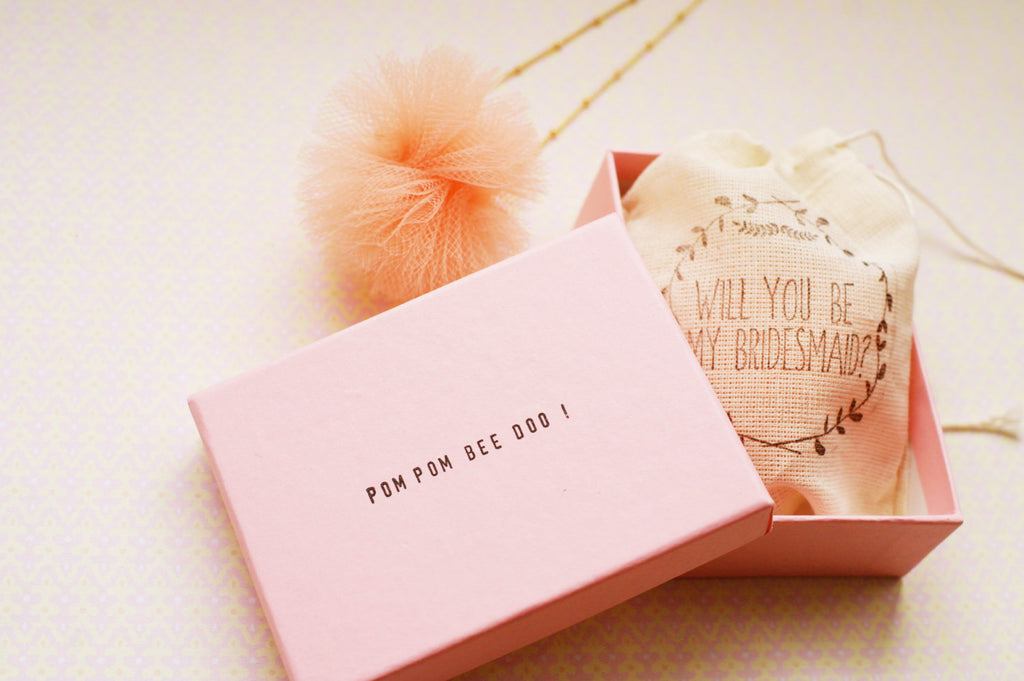 'Will you be my bridesmaid?' pom pom necklace. | The Ultimate List of Bridesmaid Proposal Ideas - 25 Creative Ways to ask Your Bridesmaids
