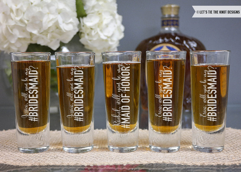 'Will you be my bridesmaid?' shotglasses. | The Ultimate List of Bridesmaid Proposal Ideas - 25 Creative Ways to ask Your Bridesmaids