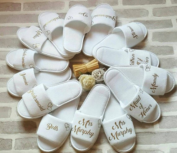 These cute matching bridesmaid slippers are the perfect bridesmaid 'thank you' gift! | 24 Bridesmaid Gifts Your Girls Will Love! | Kennedy Blue | KidsLoveHome