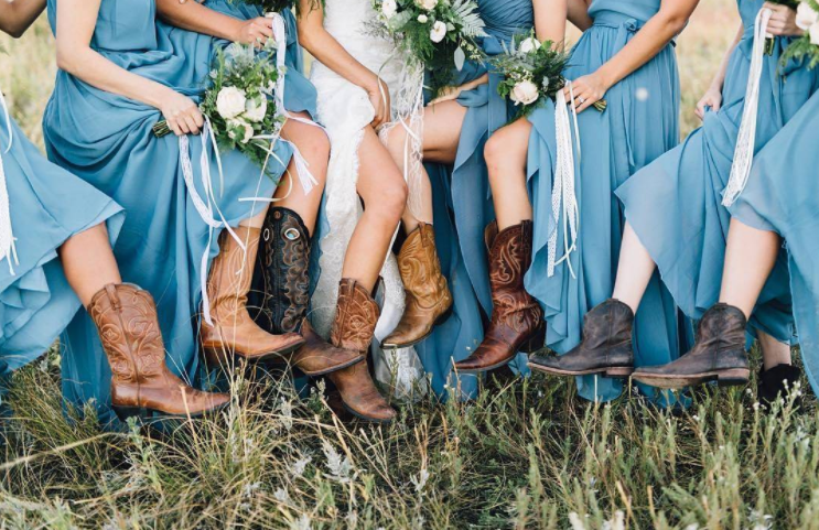 Slate blue bridesmaid dresses can be paired with any wedding! These 'maids wore cowgirl boots for their outdoor summer wedding | Kennedy Blue chiffon bridesmaid dresses are featured