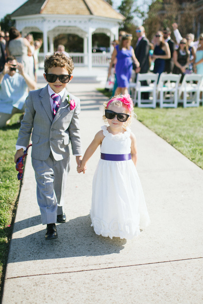 Cute photo of the kiddos walking down the aisle! | 52 Best Wedding Photo Ideas | Kennedy Blue | We Laugh We Love Photography