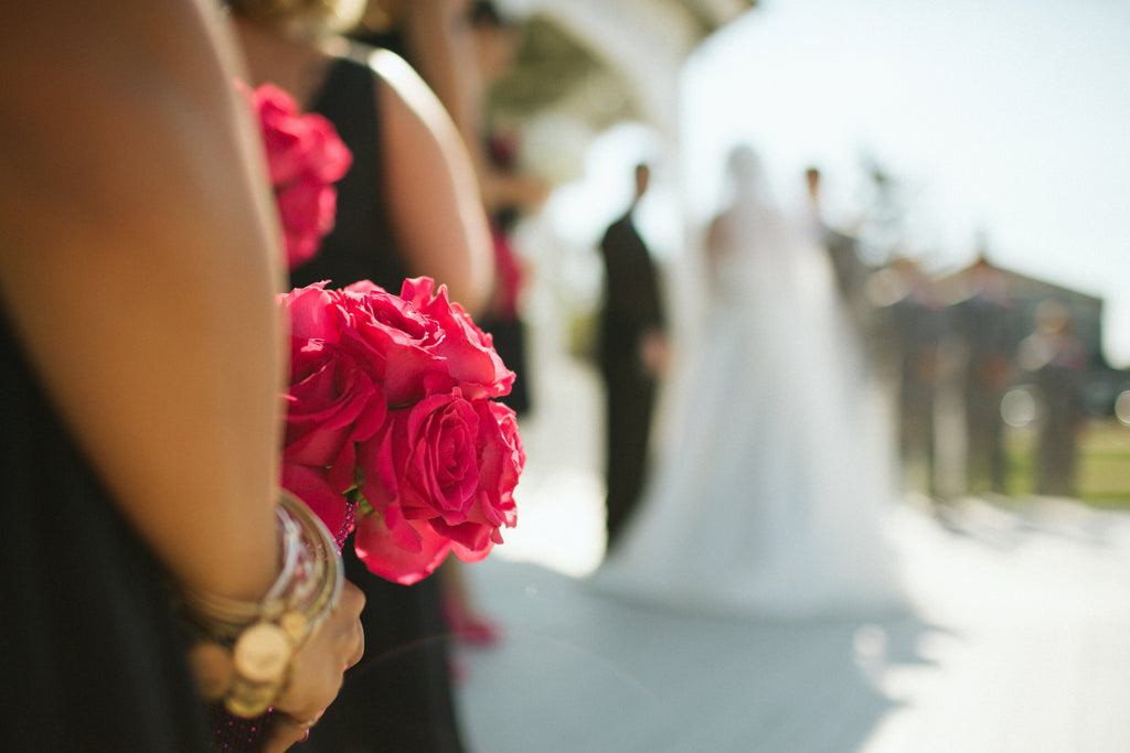 Classic pink rose bouquets for the bridesmaids. | An East Coast Wedding in Mismatched Bridesmaid Dresses