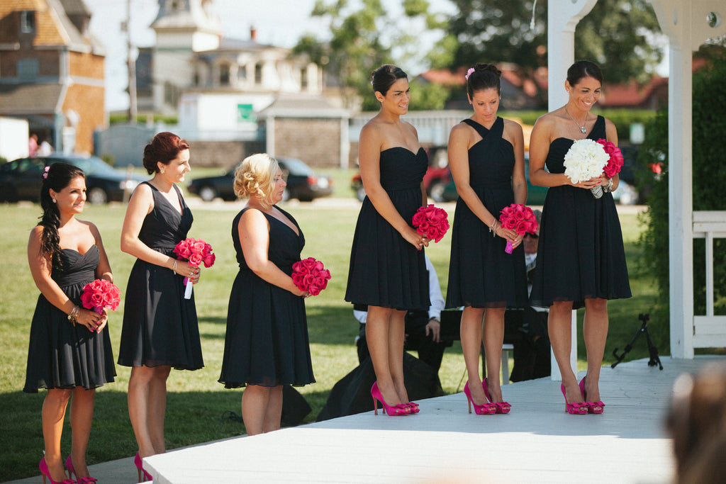 The bridesmaids looked stunning in their navy, mix and match dresses. | An East Coast Wedding in Mismatched Bridesmaid Dresses