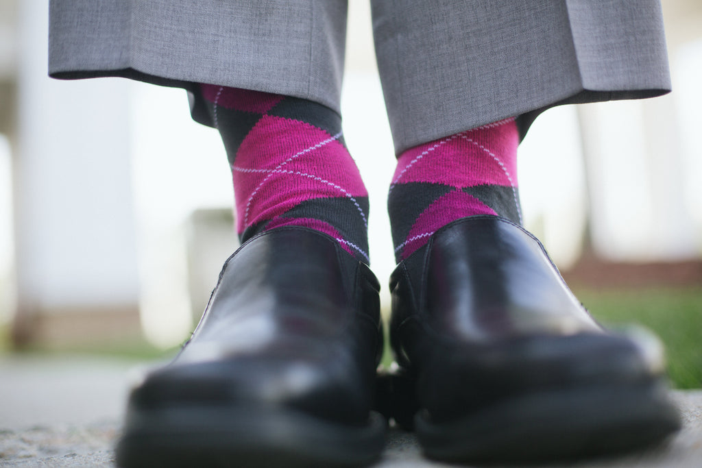 The guys wore colorful, pink socks with their suits. | An East Coast Wedding in Mismatched Bridesmaid Dresses