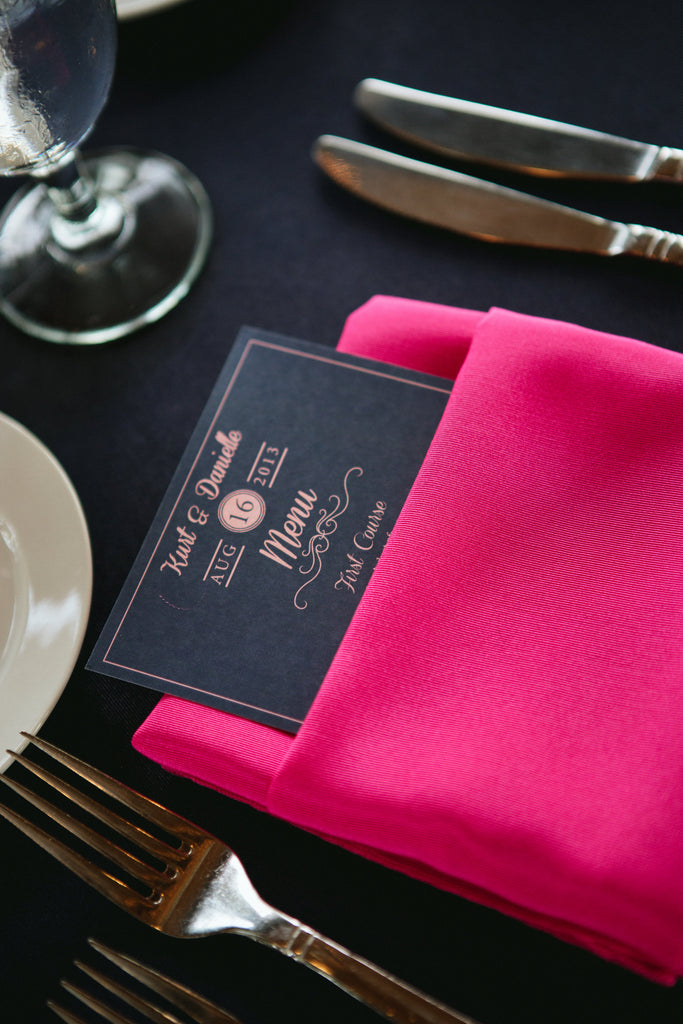 Navy and pink wedding menu and napkins. | An East Coast Wedding in Mismatched Bridesmaid Dresses