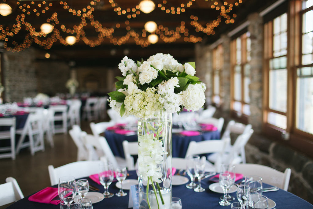 Stunning navy and pink wedding centerpieces and table settings. | An East Coast Wedding in Mismatched Bridesmaid Dresses