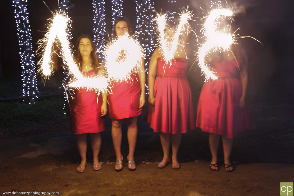 Must-Have Wedding Pictures of Bridesmaids Writing Love with Sparklers