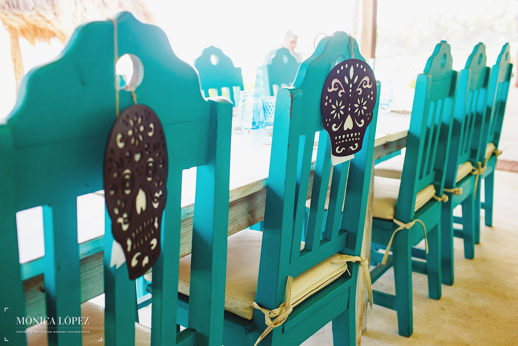 Colorful chairs with sugar skulls as decorations. | A One-Of-A-Kind Destination Wedding