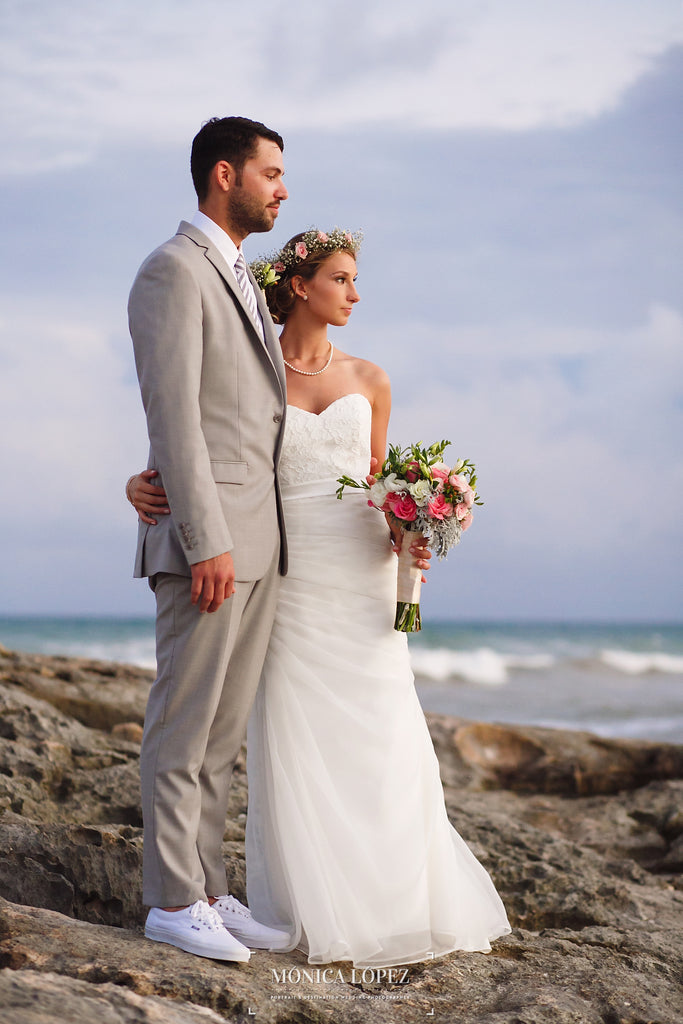 A Snapshot of a Newlywed Couple Looking at the Ocean | A One-Of-A-Kind Destination Wedding