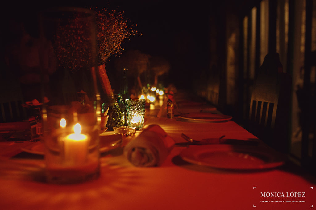 A candle-lit reception table | A One-Of-A-Kind Destination Wedding