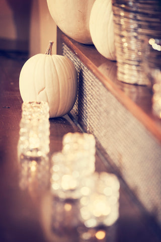 White pumpkins and candles for fall wedding decor. | A Fall Wedding Filled With Elegance and Style