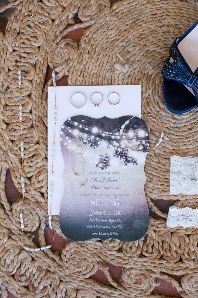 Look at this gorgeous styled photograph on the invitation and the wedding rings! | A Vintage Wedding At Sweet Pea Ranch | Kennedy Blue | Janelle Marina Photography