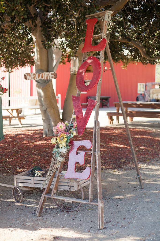 Cute 'Love' sign at the wedding! | A Vintage Wedding At Sweet Pea Ranch | Kennedy Blue | Janelle Marina Photography