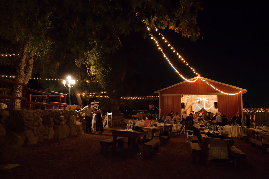 What a gorgeous view of the wedding venue at night! | A Vintage Wedding At Sweet Pea Ranch | Kennedy Blue | Janelle Marina Photography