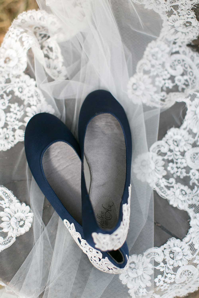 Navy blue wedding shoes with a gorgeous lace applique.