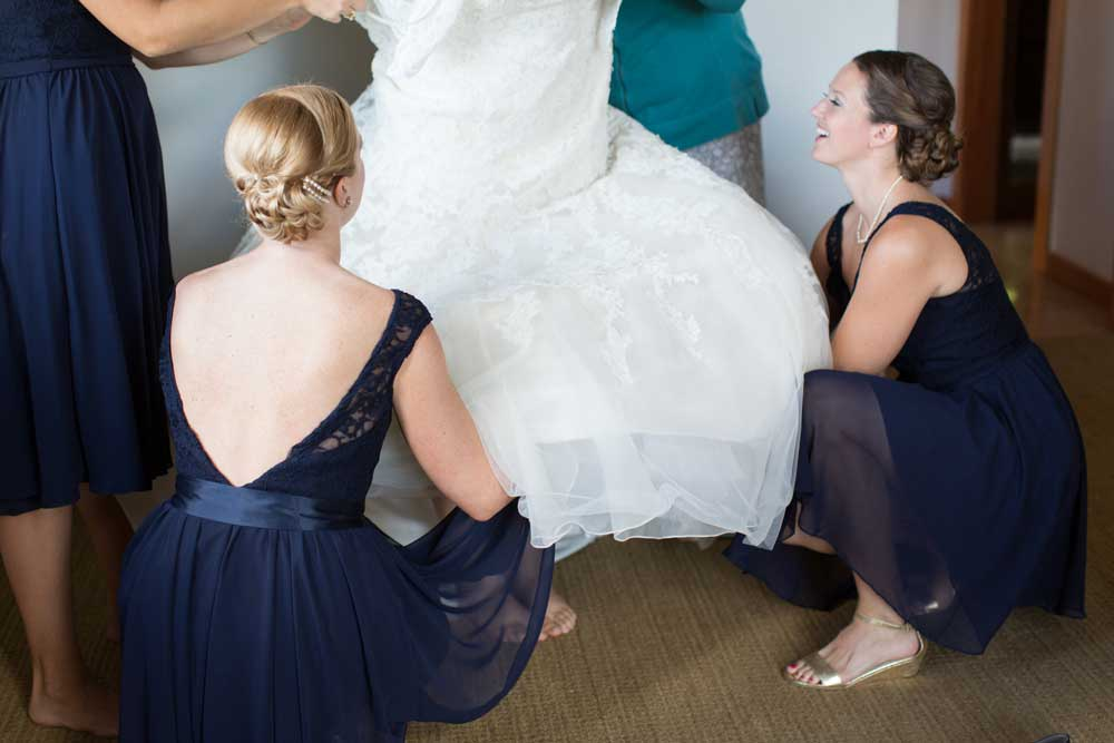 A stunning low-back bridesmaid dress in navy.