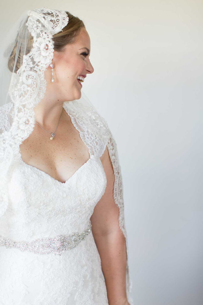 Martha wore a stunning lace-trimmed veil with her lace bridal gown.