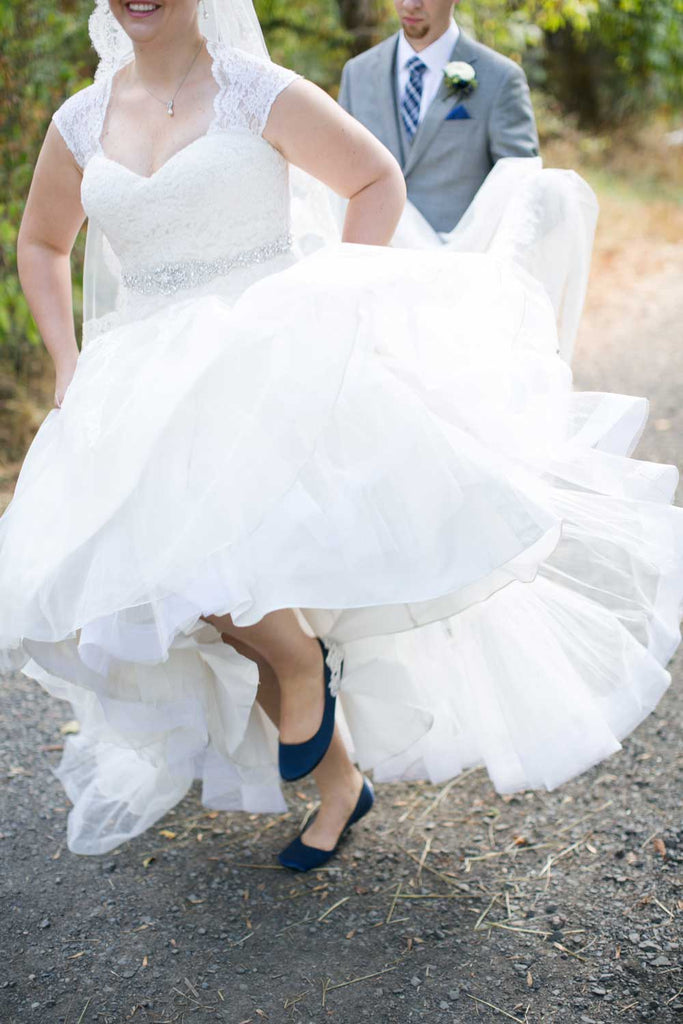 The bride wore navy shoes for her 'something blue'.