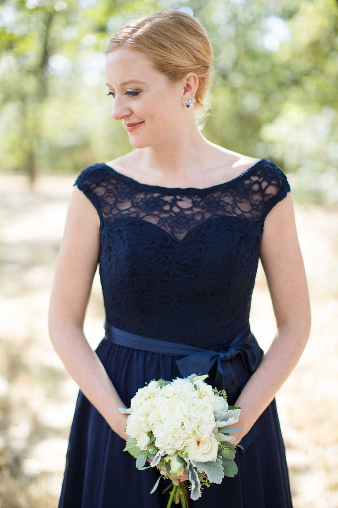How gorgeous is this illusion lace neckline on this navy bridesmaid dress?