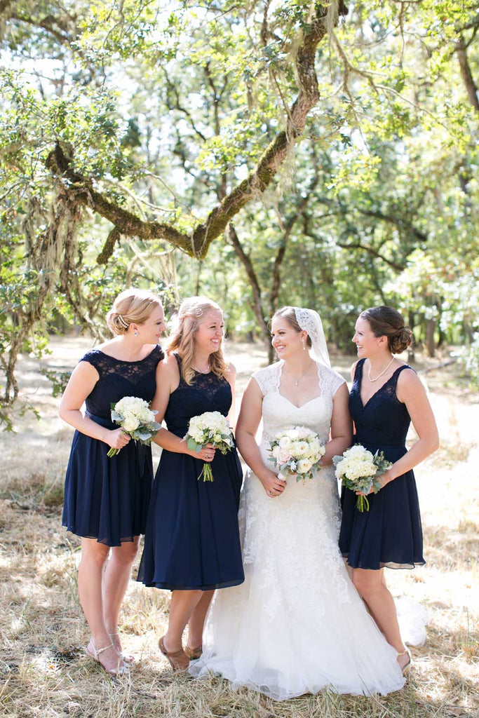 The 'maids wore mix and match navy blue bridesmaid dresses.