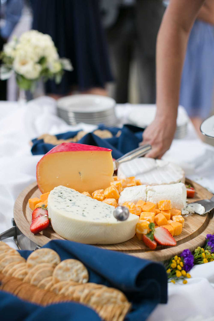 A delicious cheese plate was served at the wedding reception.