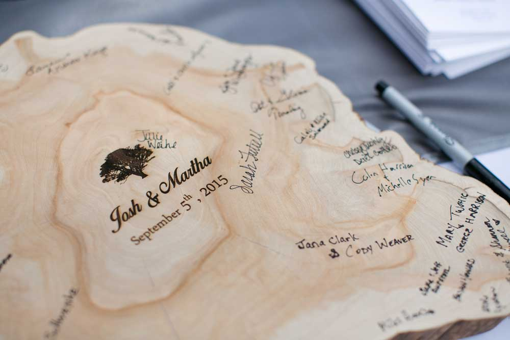 A gorgeous wood slice served as their wedding guest book.