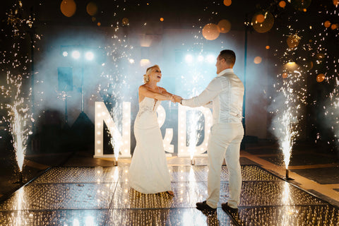 Bride and Groom spinning in circles on the dance floor.