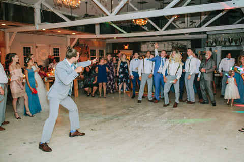 Groom tosses the garter to a crowd of guys during the Garter Toss.