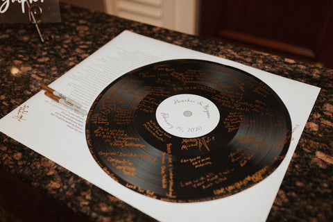 Photo of a record signed with messages from wedding guests.