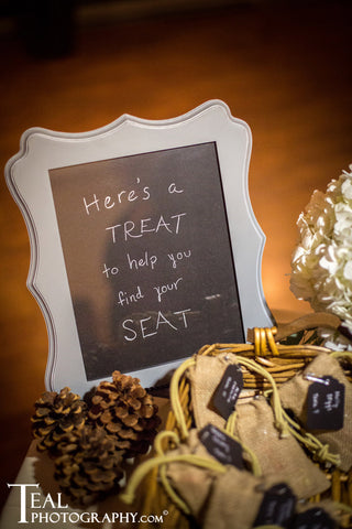 Burlap and pine cones are rustic elements for a fall wedding.