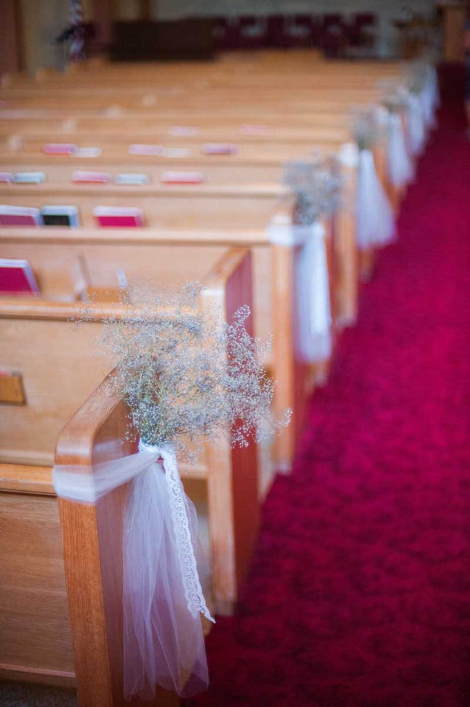 The ceremony aisles were decorated with baby's breath | A Country Chic Wedding With Stunning Vintage Details